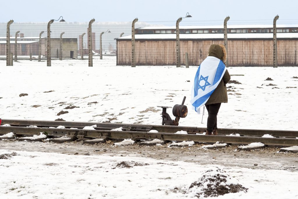 Jewish people showing flag in the extermination camp